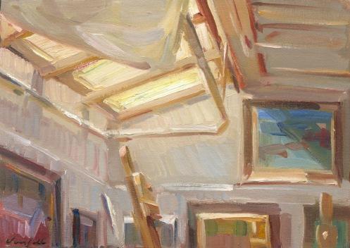 atelierraam met schilderijen aan de muur